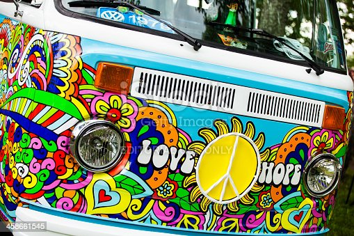 Moncton, New Brunswick, Canada - July 14, 2012: At a public car gathering, the front of classic Volkswagen Type 2 Bus.  Custom paint job showing 1960s inspired painting.  Words of