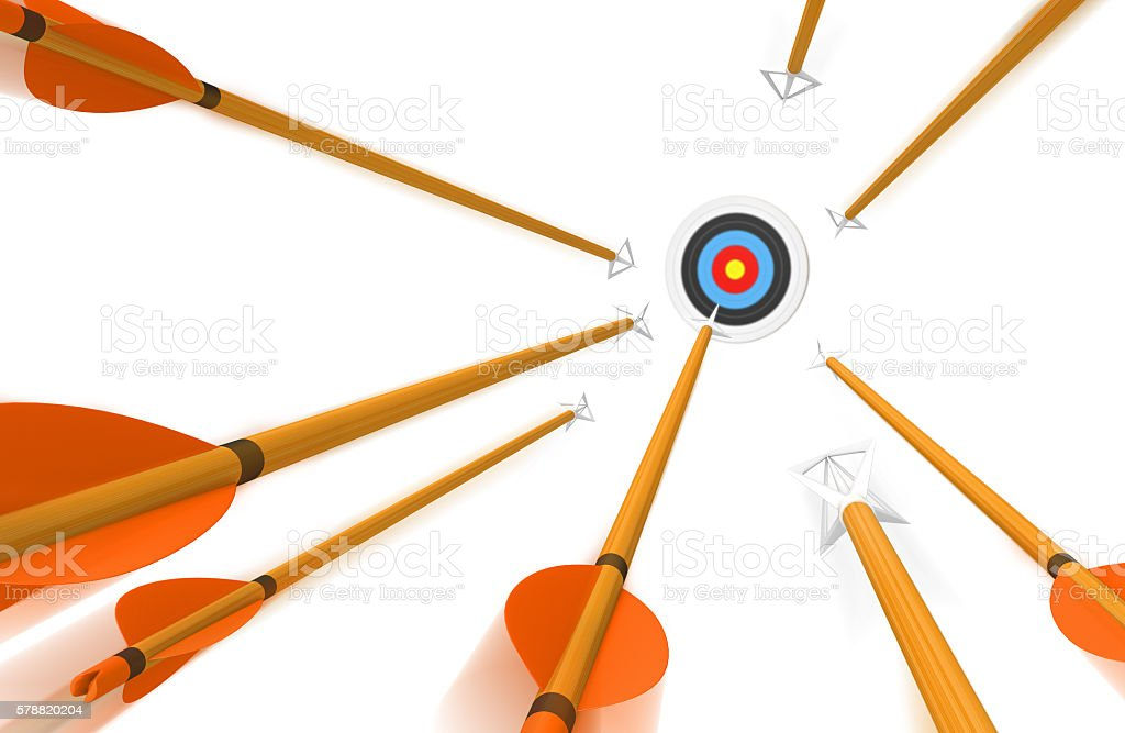 Volley of arrows hurling toward archery target in blurred motion stock photo