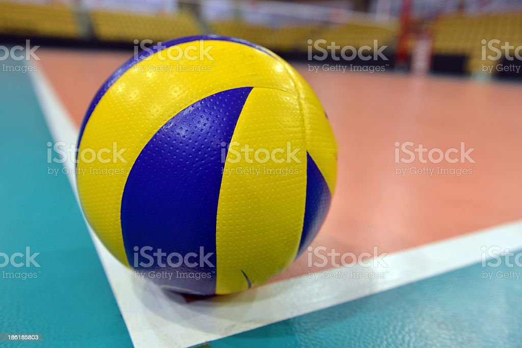 Volleyball at the edge of the gym court stock photo