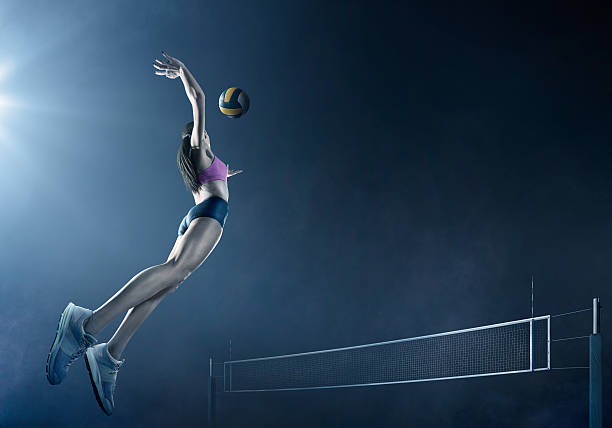 volleyball: beautiful female player in action - volleyball stock photos and pictures