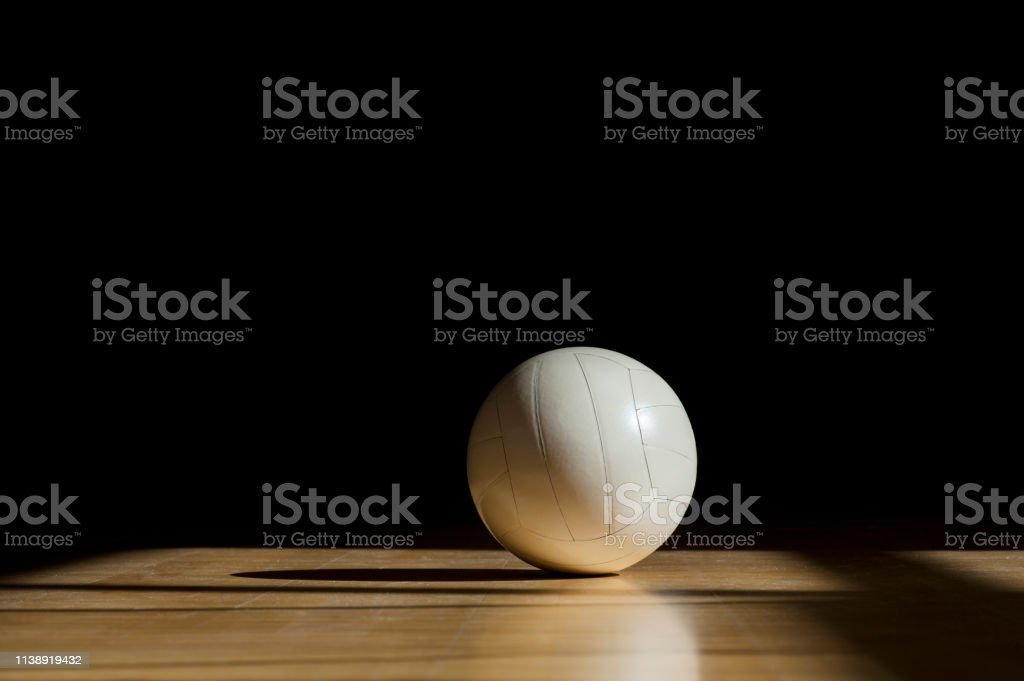 Volleyball court wooden floor with ball isolated on black with...