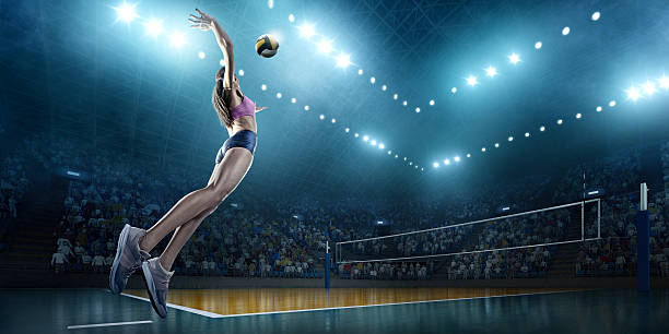volleyball: female player in action - volley ball photos et images de collection