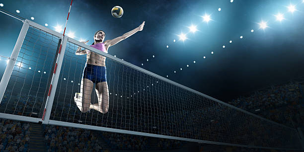 volleyball: female player in action - バレーボール ストックフォトと画像