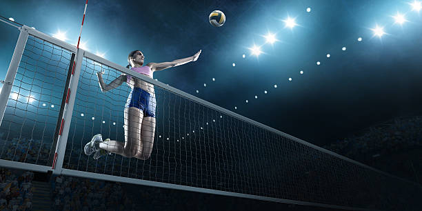 Volleyball: Female player in action - foto de acervo
