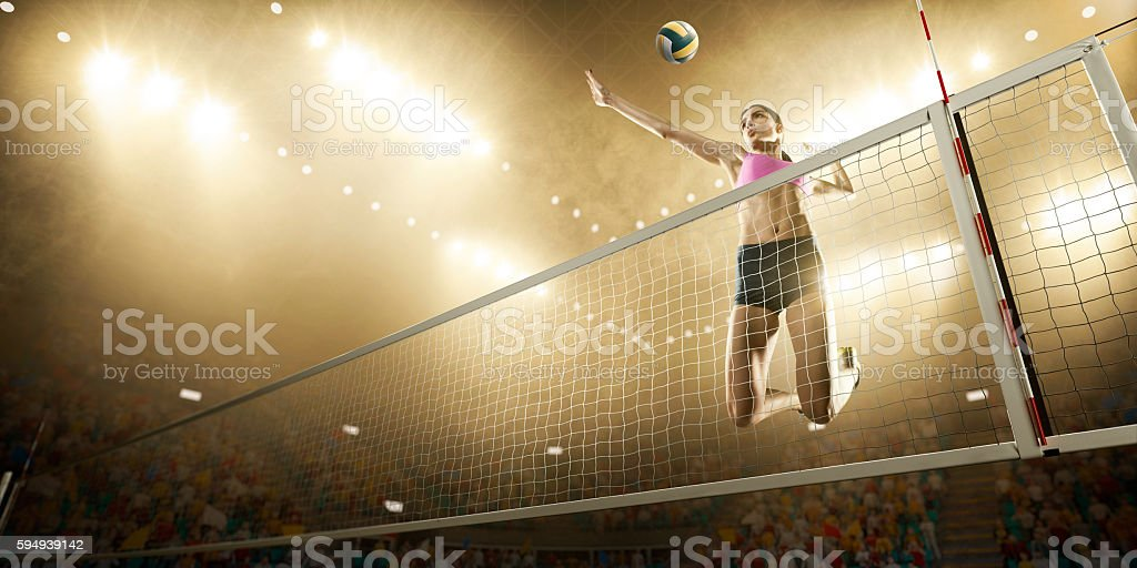 Volleyball: Female player in action - Photo