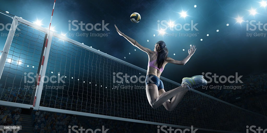 Volleyball: Female player in action - foto de stock
