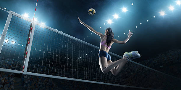 volleyball: female player in action - volleyball sport stock photos and pictures
