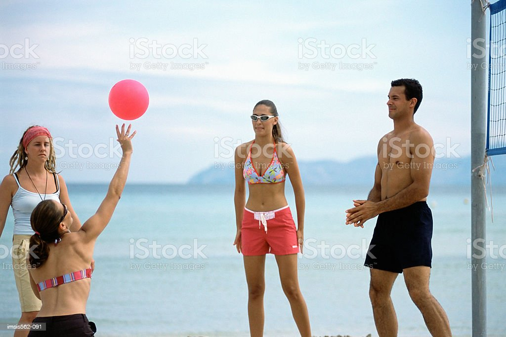 Volleyball game on beach royalty-free stock photo