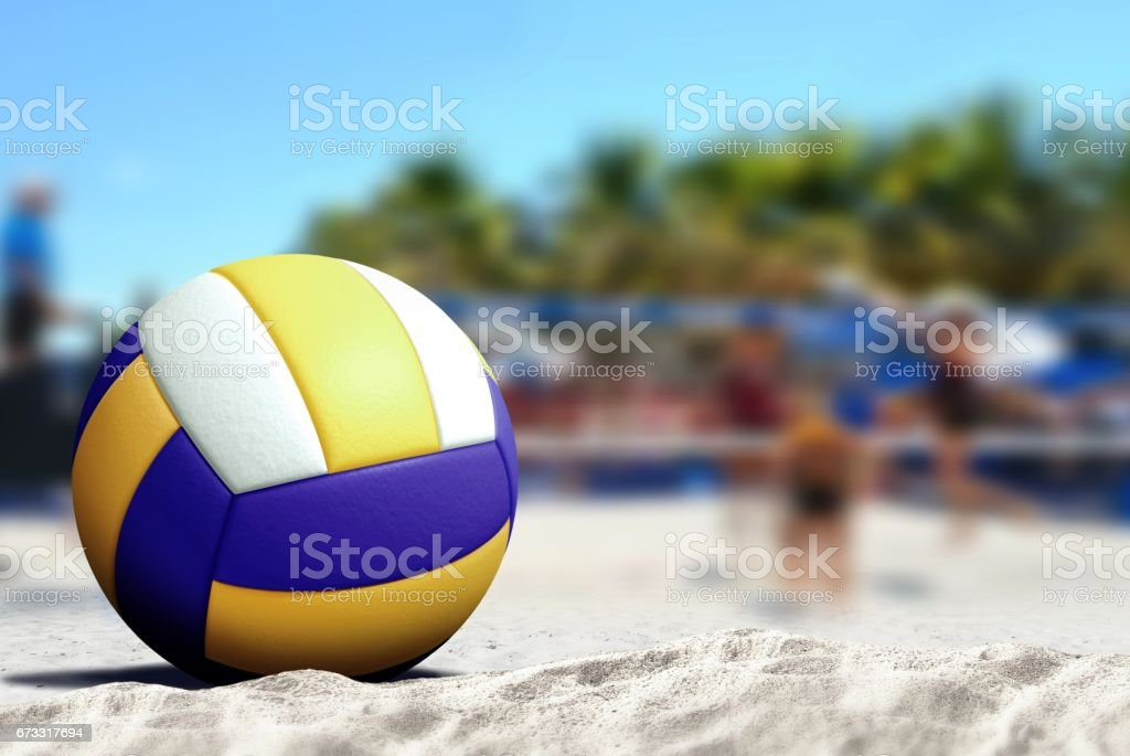Volleyball game on sandy beach stock photo