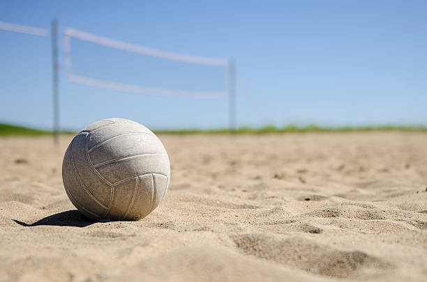 Volleyball in the sand stock photo