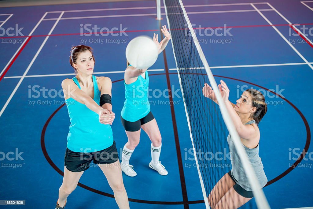 Volleyball is Bumped Over Net stock photo