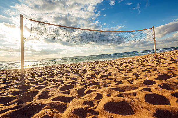 Volleyball net and sunrise on the beach stock photo