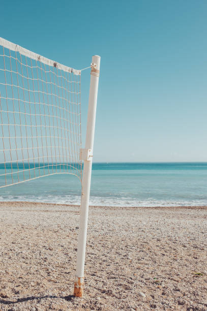 Volleyball net at the beach stock photo