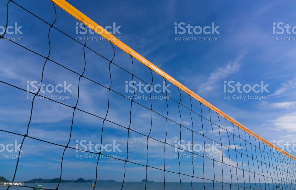 Volleyball net on the beach with a clear sunny sky royalty-free stock photo