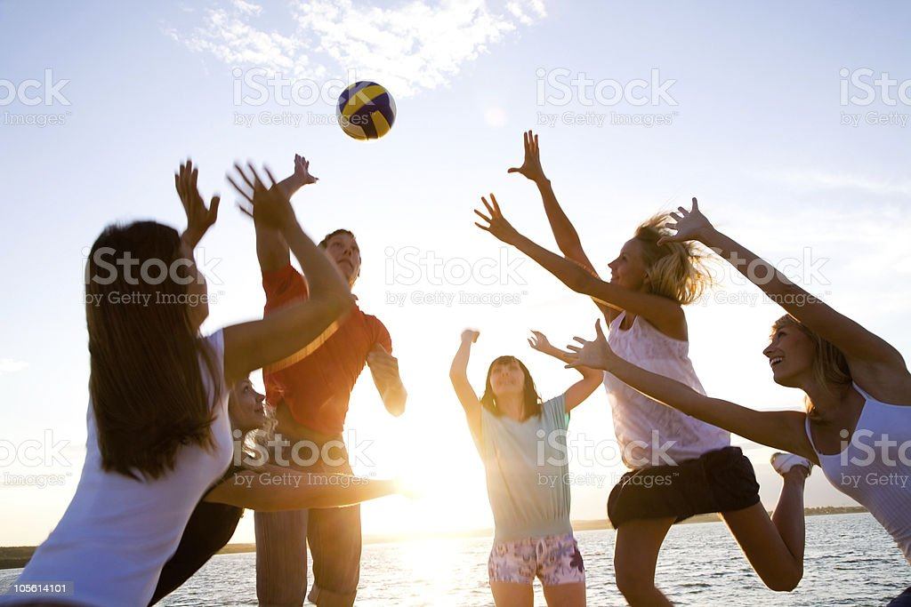 volleyball on the beach  Adolescence Stock Photo