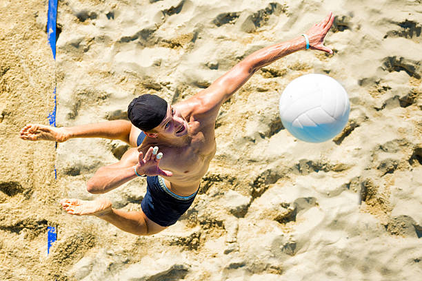 Volleyball player at service stock photo