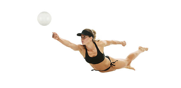 Volleyball player in action stock photo