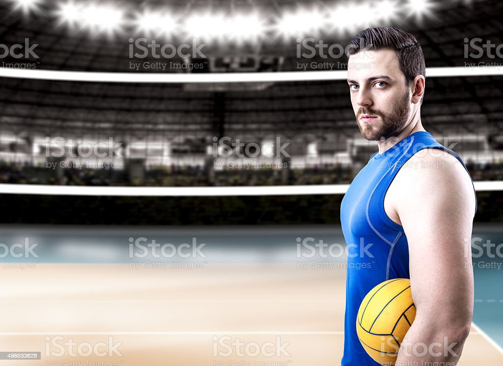Volleyball player on blue uniform on volleyball court stock photo