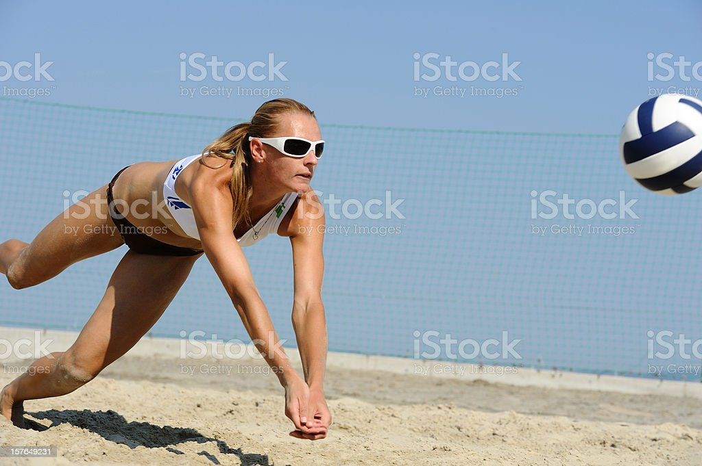 Volleyball player saving the ball in attractive way stock photo