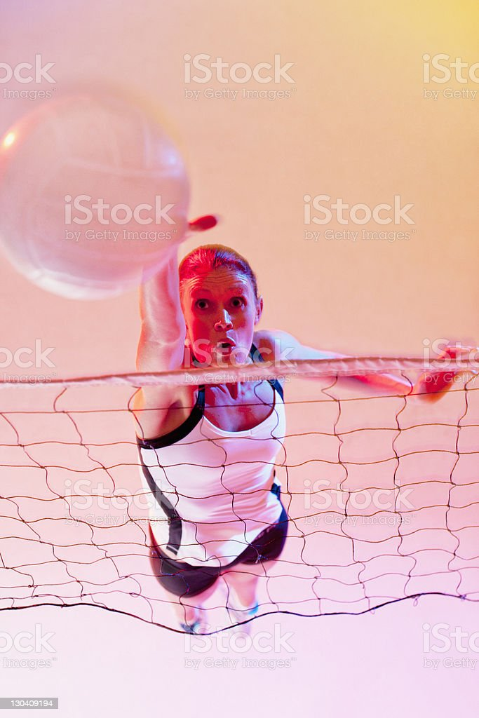 Volleyball player spiking ball over net royalty-free stock photo