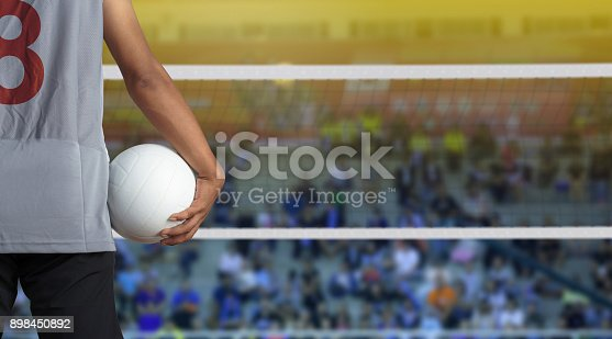 istock Volleyball player with ball on volleyball court 898450892