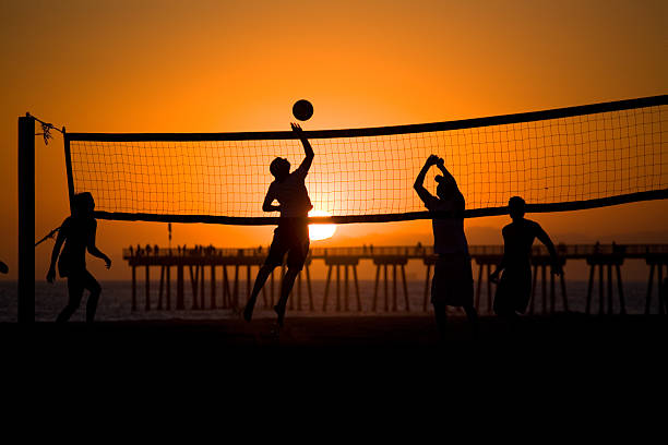 Volleyball players at sunset, 10th St. in Hermosa Beach stock photo