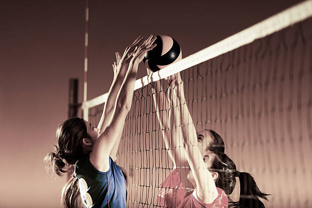 volleyball players in action. - volleyball sport stock photos and pictures