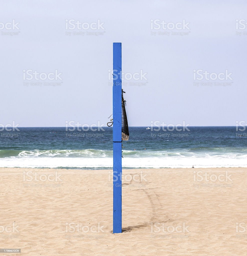 volleyball post at the beach in blue royalty-free stock photo