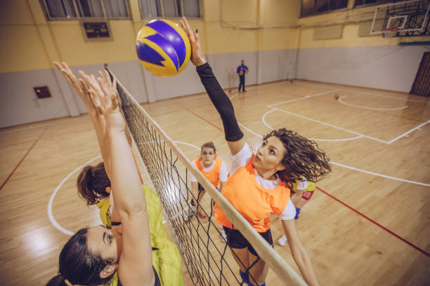 volleyball team in action - volleyball sport stock photos and pictures