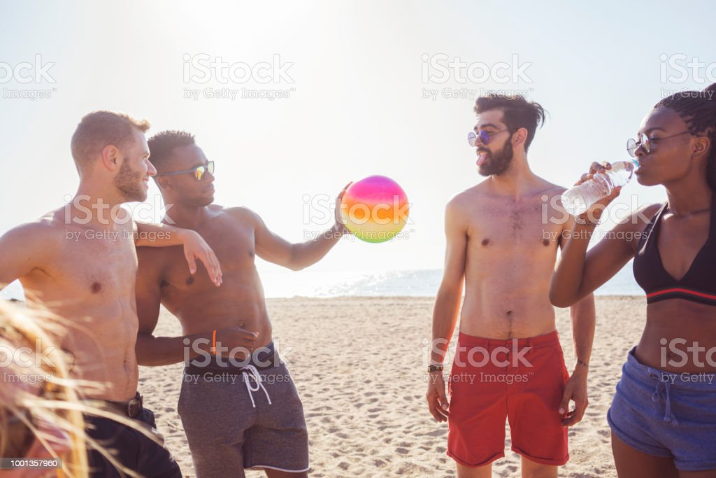 Volleyball with friends at the beach stock photo