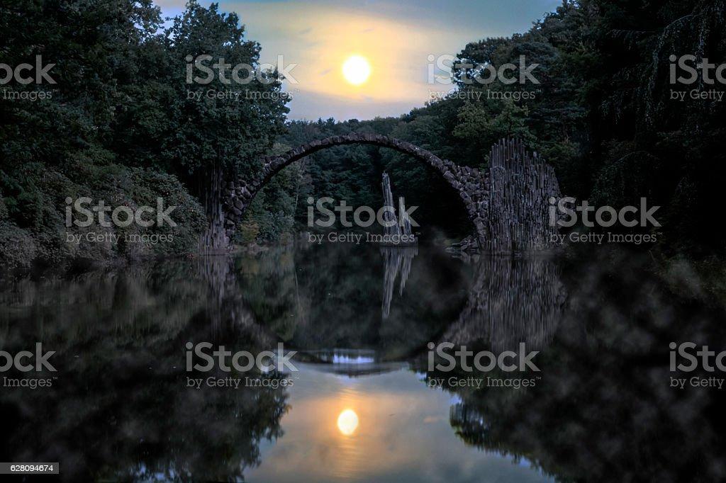 Vollmond ueber der Rakotzbrücke stock photo