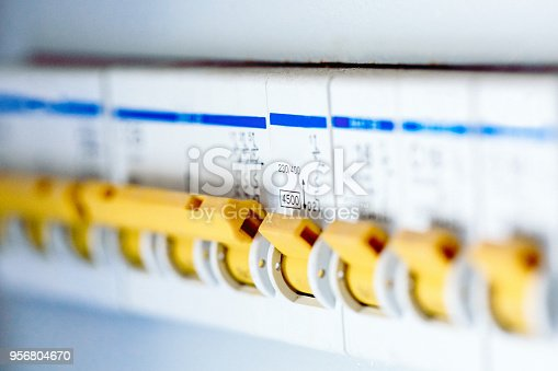 istock Voltage switchboard with circuit breakers are are in the ON position in the electric box. Electrical background. 956804670