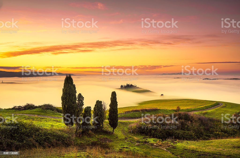 Volterra fog and sea  clouds, rolling hills panorama on sunset stock photo