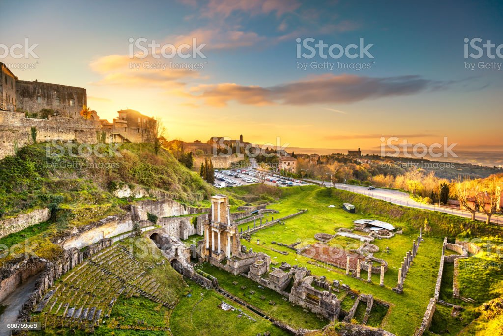 Volterra, roman theatre ruins at sunset. Tuscany, Italy. stock photo