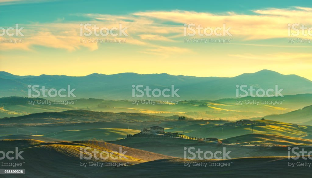 Volterra winter panorama, rolling hills and green fields on suns stock photo