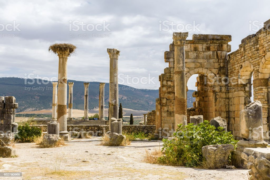 Volubilis Ruins In Blue Sky And White Clouds Meknes Morocco