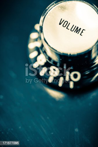 Volume control knob on a electric guitar. Shallow depth of field. Vintage mood.