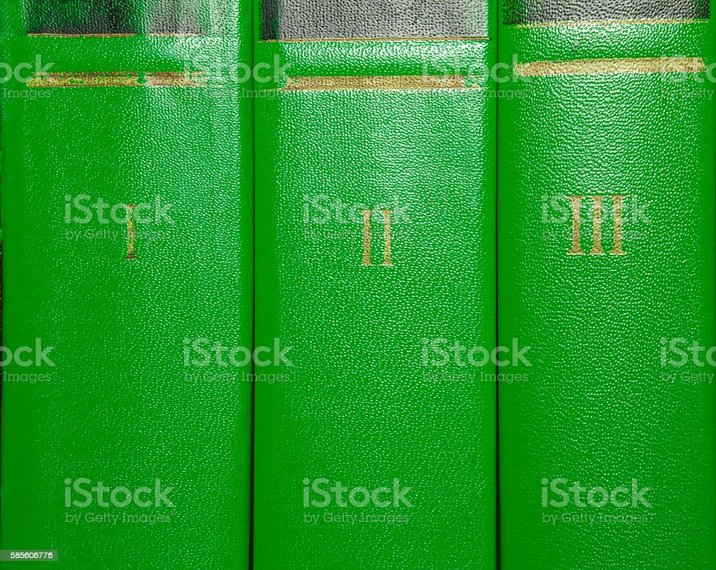 Volumes of old books with gold lettering on the cover stock photo