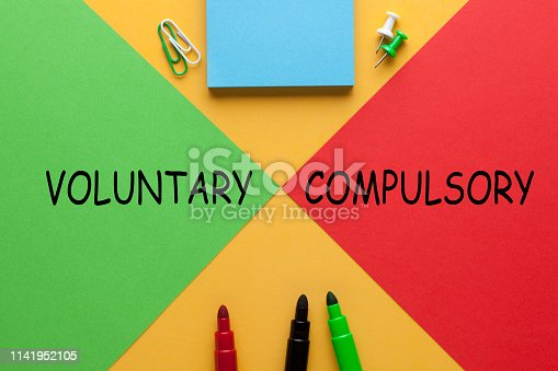 Colour sheets red vs. green with words Voluntary or Compulsory  and various stationery.