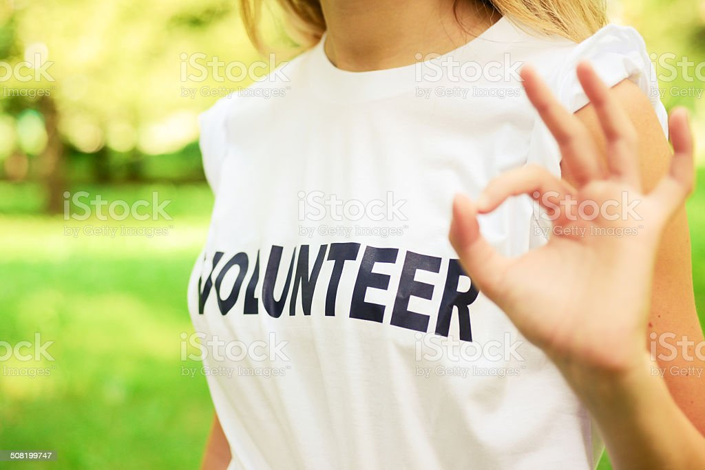 Volunteer and Ok Sign stock photo