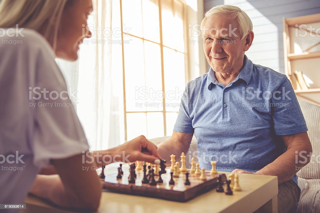 Volunteer and old people - foto de stock