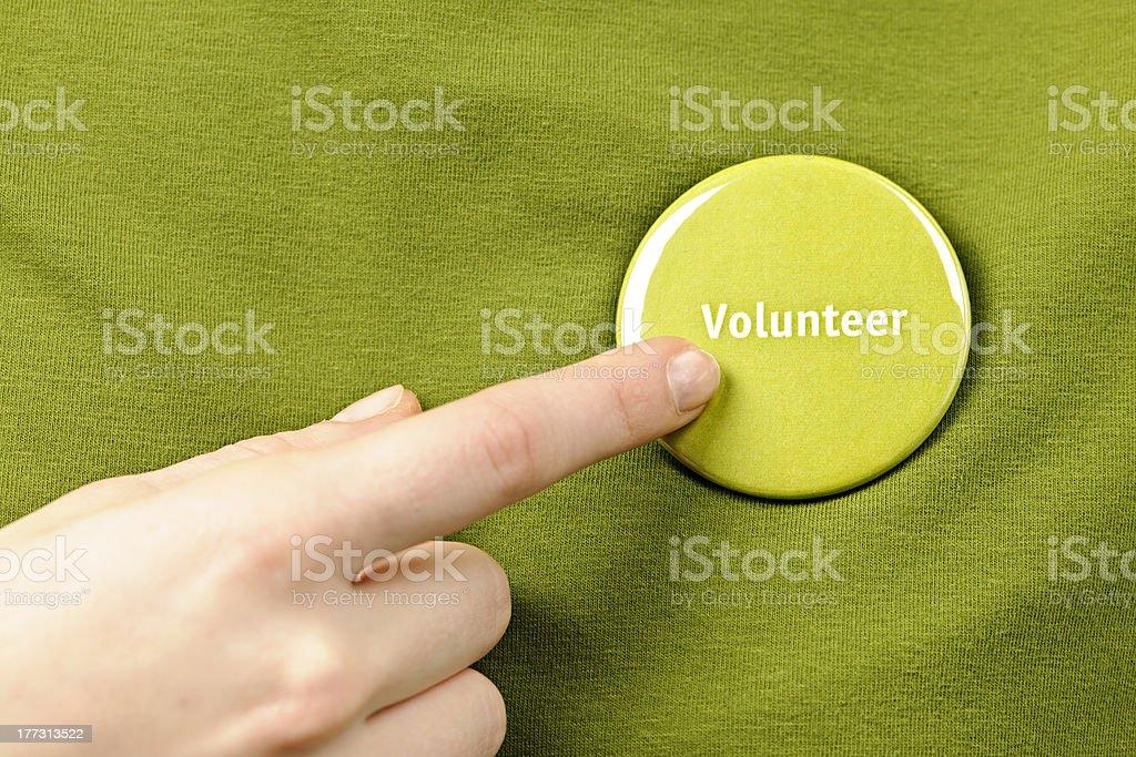 Volunteer button stock photo