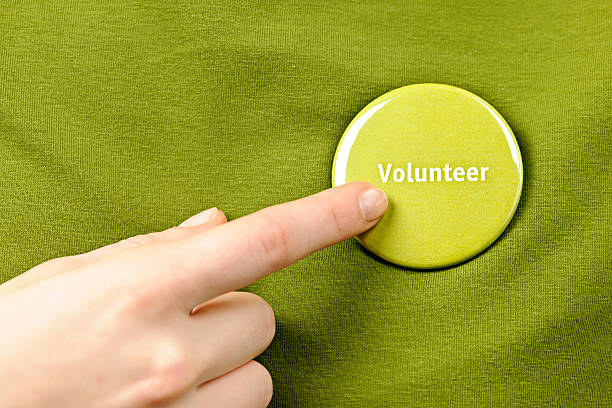 Volunteer button stock photo