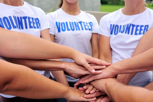 Volunteer Group Hands Together Stock Photo - Download Image Now