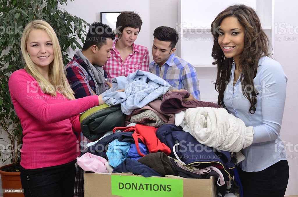 Volunteer group with donations stock photo