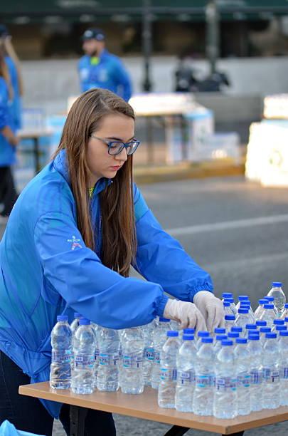 Volunteer is preparing bottles of water stock photo