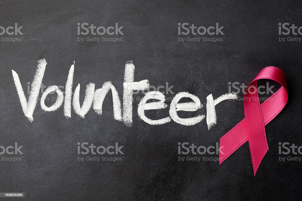 Volunteer - Pink awareness ribbon stock photo
