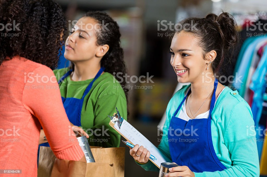 Volunteer receives donation at food and clothing drive stock photo