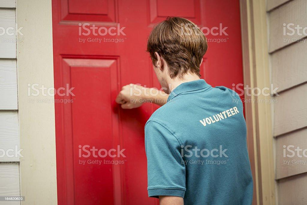 Volunteer Street Canvasser Knocking On Doors royalty-free stock photo