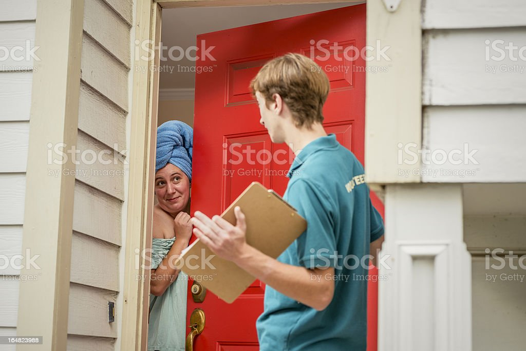 Volunteer Street Canvasser Surprised By Flirtatious Woman A young canvasser gets a surprise at the door by a flirtatious woman who just got out of the shower. Adult Stock Photo